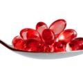 Omega-3 pills on spoon