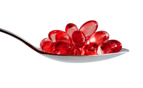 Omega-3 pills on spoon